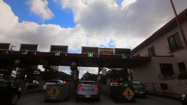 vídeos de stock e filmes b-roll de forward: congested toll gates of california - cabina de portagem