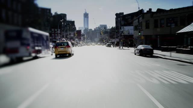 Forward POV driving down 7th Avenue soft focus effect.