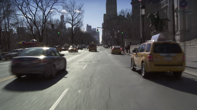 Forward POV driving down Central Park West past the 'American Museum of Natural History'
