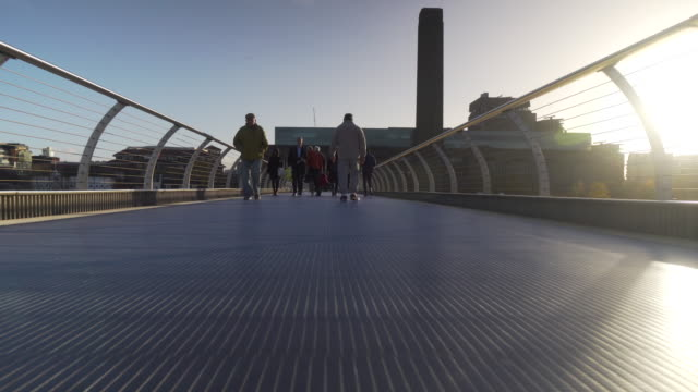 forward pov shot moving across the millennium bridge towards tate modern on london's south bank. - city von london stock-videos und b-roll-filmmaterial