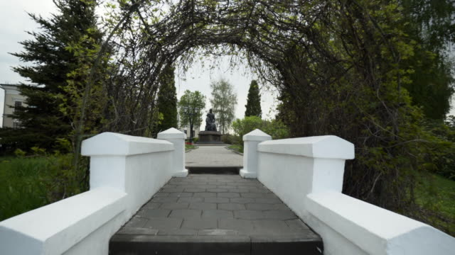 forward slow: beautiful garden with statue in the middle of the area - kazan, russia - kazan russia stock videos and b-roll footage