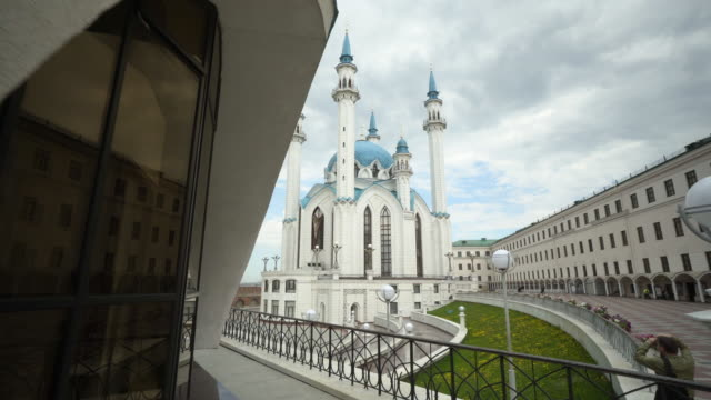forward slow: beautiful towers of mosque with grey clouds in the background - kazan, russia - kazan russia stock videos and b-roll footage