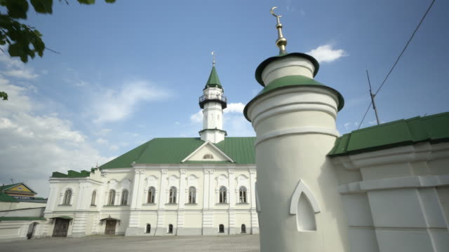 forward slow: green and white building featuring its design on a sunny day - kazan, russia - kazan russia stock videos and b-roll footage