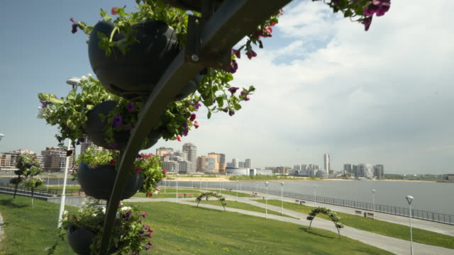 forward slow: nature filled park near the river with mix of the urban area - kazan, russia - kazan russia stock videos and b-roll footage
