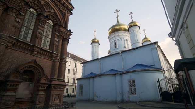 forward slow pan left to right: church in the middle of the city with crosses on top of the structure - kazan, russia - kazan russia stock videos and b-roll footage