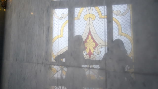 forward slow: two looking at the stained glass while leaning on a steel railing - kazan, russia - kazan russia stock videos and b-roll footage