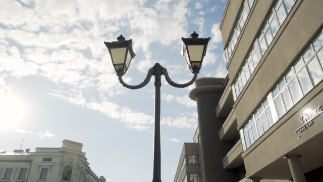 forward tilt-upward: lamp post and the blue sky covered with clouds - kazan, russia - kazan russia stock videos and b-roll footage