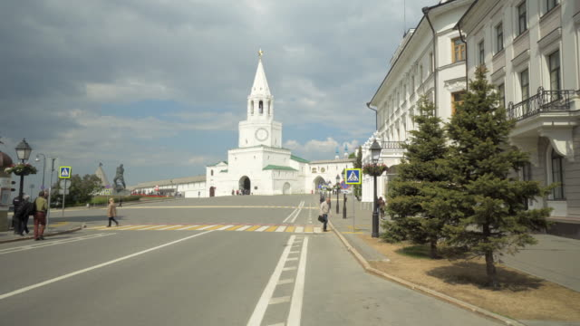 forward time-lapse: people exploring white building with statue and pine trees in the area - kazan, russia - kazan russia stock videos and b-roll footage
