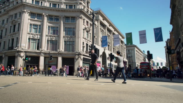 forward tracaking shot moving across oxford circus, london. - tracking shot stock videos & royalty-free footage