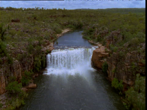 forward track over waterfall in east alligator river, northern territory, australia - rapid stock videos & royalty-free footage