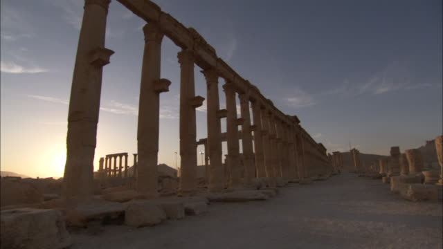 Forward tracking shot along a section of the grand colonnade in the ancient city of Palmyra. Available in HD