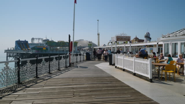 pov forward tracking shot along brighton's palace pier. - western script stock videos & royalty-free footage