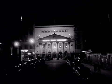 forward tracking shot along charles ii street towards the floodlit exterior of the theatre royal haymarket. 1956. - theatre royal haymarket stock videos & royalty-free footage