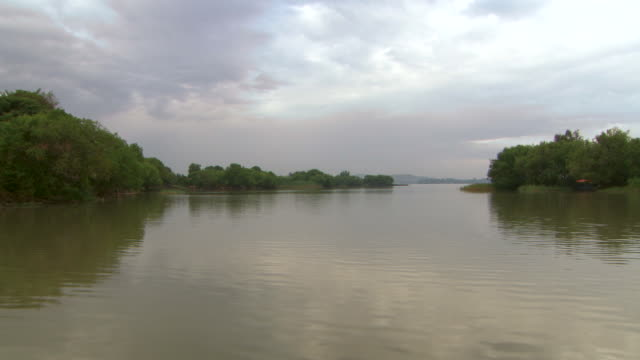 forward tracking shot along lake tana, passing various small islands.  - horn of africa stock videos and b-roll footage