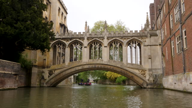 Forward tracking shot along the River Cam moving towards the Bridge of Sighs at St John's College, Cambridge.