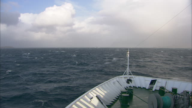 forward tracking shot from the prow of a passenger ferry.  - schiffsdeck stock-videos und b-roll-filmmaterial