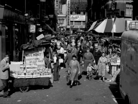 vídeos de stock, filmes e b-roll de forward tracking shot from the top of a car up rupert street soho moving through a busy street market - moving activity