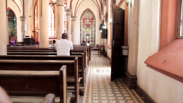 Forward tracking shot inside the Sacred Heart Cathedral in Lome, Togo.