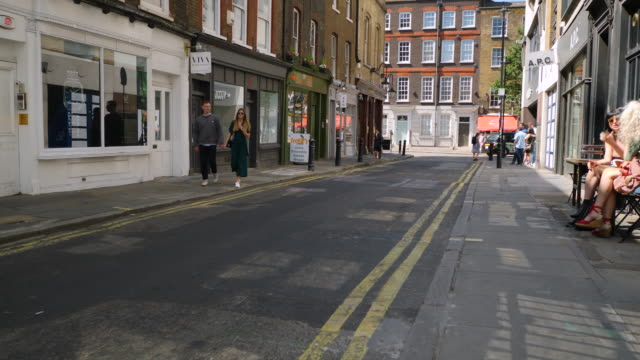 Forward tracking shot moving along London's Lexington Street.