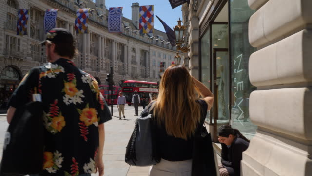 Forward tracking shot moving along London's Regent Street.