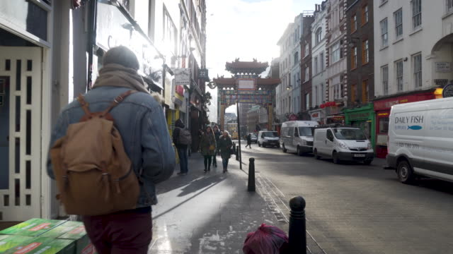 Forward tracking shot moving along Wardour Street in London's Chinatown district.