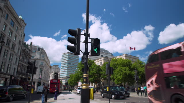 forward tracking shot near nelson's column. - traffic light stock videos & royalty-free footage