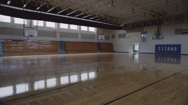 forward tracking shot of an empty school gym. - organisation stock videos & royalty-free footage