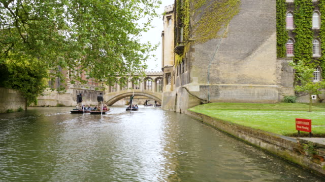 Forward tracking shot on the River Cam towards the Bridge of Sighs at St John's College, Cambridge.