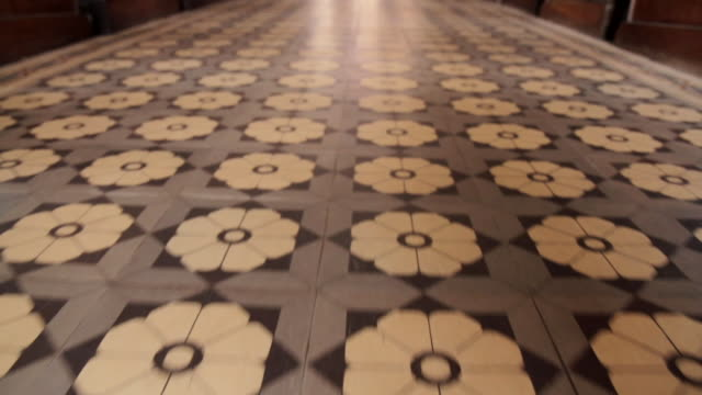 forward tracking shot over the beautiful floor tiles in the sacred heart cathedral in lome, togo. - tiled floor stock videos & royalty-free footage