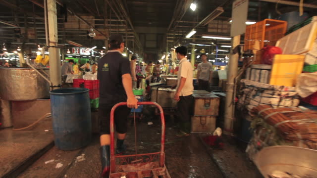 forward tracking shot through a fish market in ho chi minh city. - cart stock videos and b-roll footage