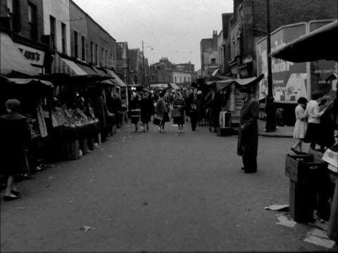 forward tracking shot through a street market in the whitechapel area of london - street market stock videos & royalty-free footage