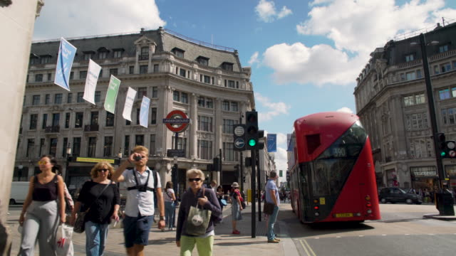 forward tracking shot to the entrance to oxford circus tube station. - oxford street stock-videos und b-roll-filmmaterial
