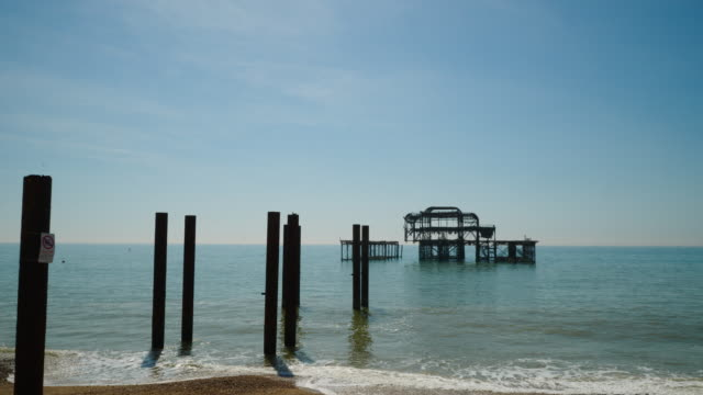 forward tracking shot towards the derelict west pier on brighton beach. - imperfection stock videos and b-roll footage