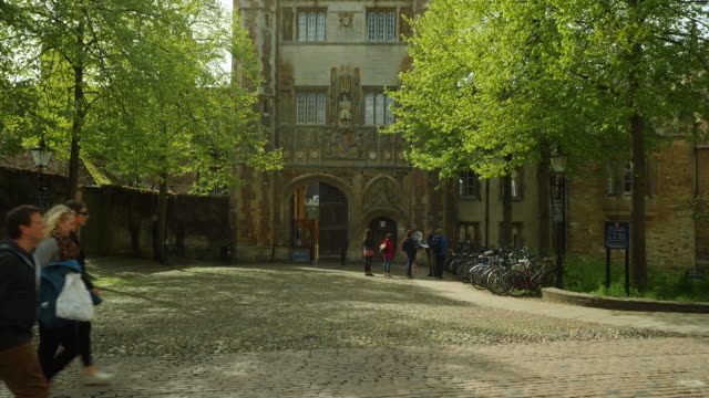 forward tracking shot towards the entrance to trinity college, cambridge. - trinity college cambridge university stock videos & royalty-free footage