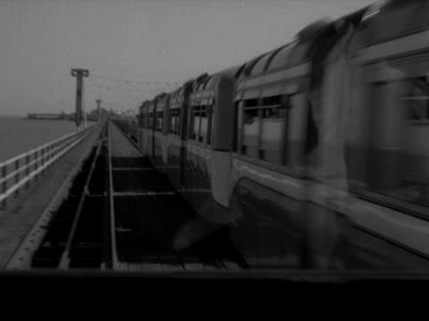 forward tracking shots moving along the railway track on southend pier. - railroad track stock videos & royalty-free footage