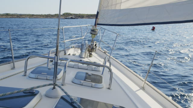 ms, pov forward view from a boat sailing / ibiza, spain - small boat stock videos & royalty-free footage