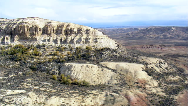 fossil butte national monument  - aerial view - wyoming, lincoln county, united states - butte rocky outcrop stock videos & royalty-free footage