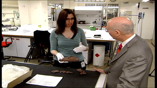 fossil of ancient fish found; england: london: science museum: int rachel bowden showing fossil to rush and sot - in fish the bones of the head are... - fx network stock videos & royalty-free footage