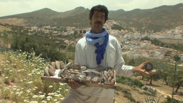 MS Fossil vendor showing merchandise, Moulay Idriss, Morocco
