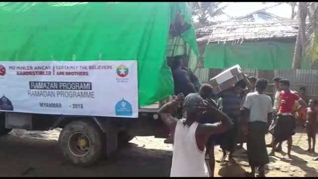 A foundation linked to Turkey's religious authority distributed aid to Rohingya Muslims living in crisis in Myanmar during the month of Ramadan a...