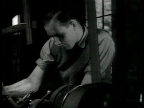foundry workers at machines ms young man working machine vs men pounding hot iron metal w/ machine press ms worker wwii world war ii war effort war... - foundry worker stock videos and b-roll footage
