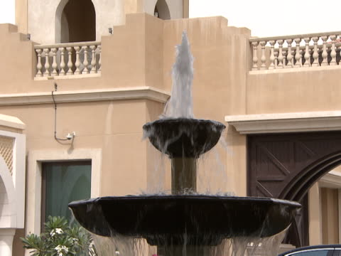 fountain, abu dhabi. view of the top two tiers of a bubbling fountain. - architecture stock videos & royalty-free footage