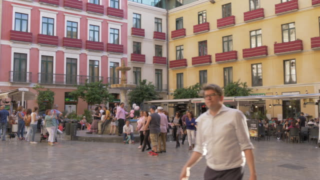 Fountain and people in town Plaza, Malaga, Andalucia, Spain, Europe