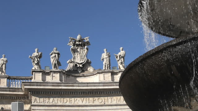 CU Fountain and statues of Alexander VII Pont Max at St. Peter's Square / Vatican City, Italy