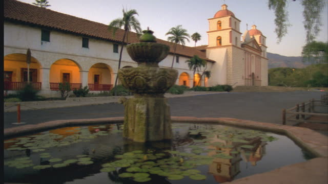 ms fountain at mission santa barbara at dusk / california, usa - santa barbara california stock videos & royalty-free footage