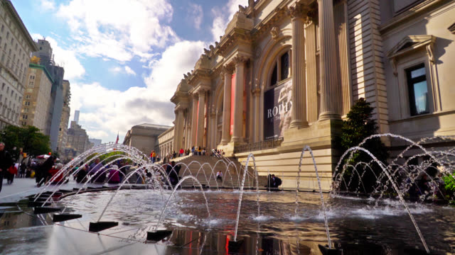 fountain at the met museum. waterfront. the sky with clouds and financial buildings reflection in water. famous place. travel destination for tourists and new yorkers. - metropolitan museum of art new york city stock videos & royalty-free footage