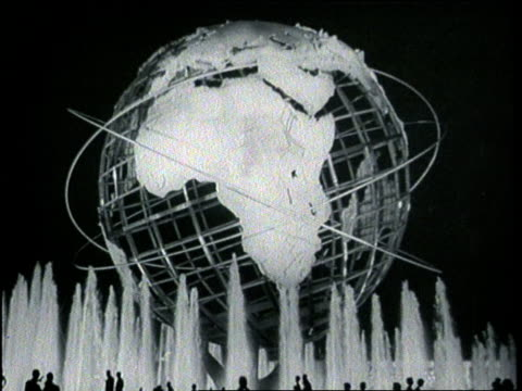 a fountain bubbles beneath the unisphere globe at the world's fair - flushing meadows corona park stock videos and b-roll footage