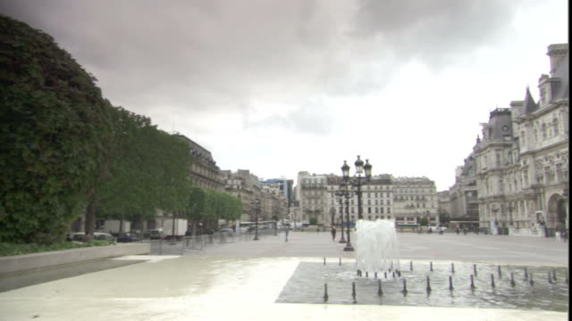 a fountain bubbles in the quad at the hotel de ville in paris. - hotel de ville paris stock videos & royalty-free footage