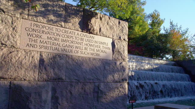 a fountain cascades near an inscription at the franklin delano roosevelt memorial in washington, d.c. - civilian conservation corps stock-videos und b-roll-filmmaterial