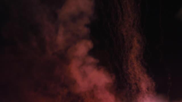 vídeos y material grabado en eventos de stock de fountain fireworks raining down in sparks against multicolored smoke - sparks